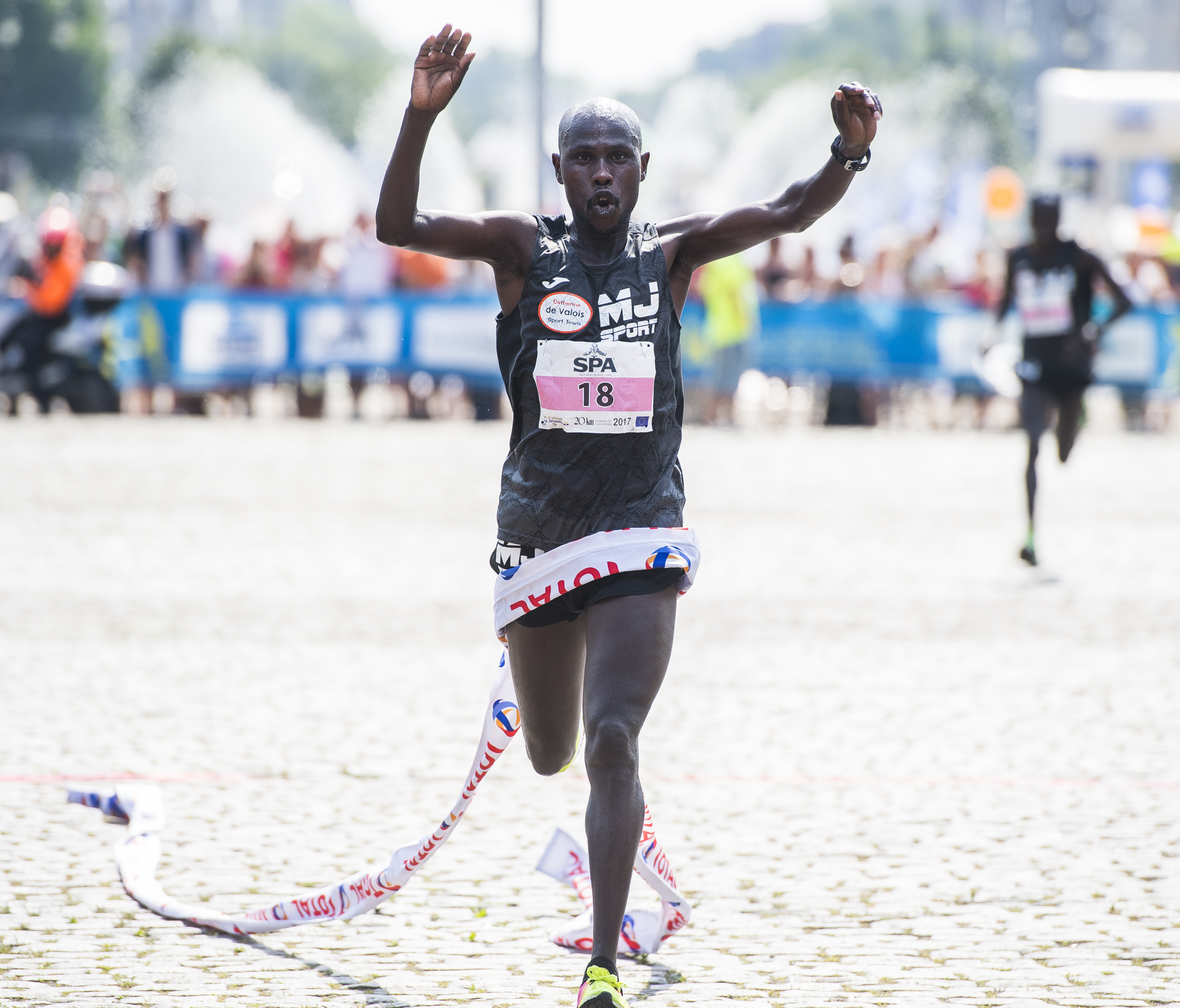 Winner David Maru from Kenya celebrates as he crosses the finish line at the 38th edition of the Brussels' 20km run, Sunday 28 May 2017, in Brussels. BELGA PHOTO LAURIE DIEFFEMBACQ
