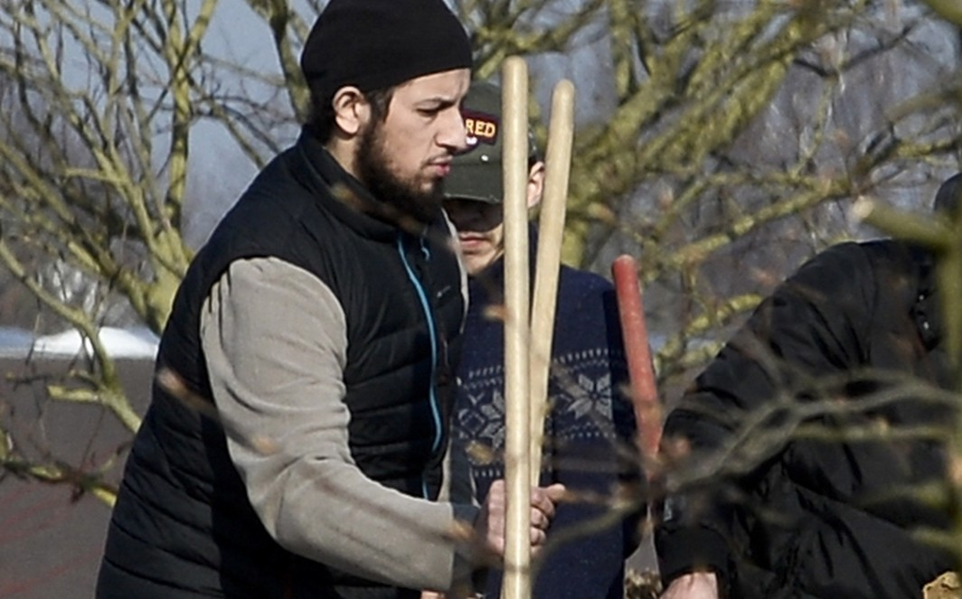Family and relatives, including Abid Aberkan (L) pictured at the funeral ceremony of Brahim Abdeslam, one of the terrorist of last November Paris attacks, at the interdenominational cemetery of Schaerbeek in Brussels, Thursday 17 March 2016. Brahim Abdeslam took part in the terraces attacks and committed suicide with a bomb at 'Le Comptoir Voltaire' in Paris. Abid Aberkan was arrested by police in Jette after the arrest of Salah Abdeslam in Molenbeek on Friday 18 March 2016. After Tuesday shooting in Vorst - Forest, Salah called Abid Aberkan who found a place to hide him, in his mother's house. BELGA PHOTO STRINGER