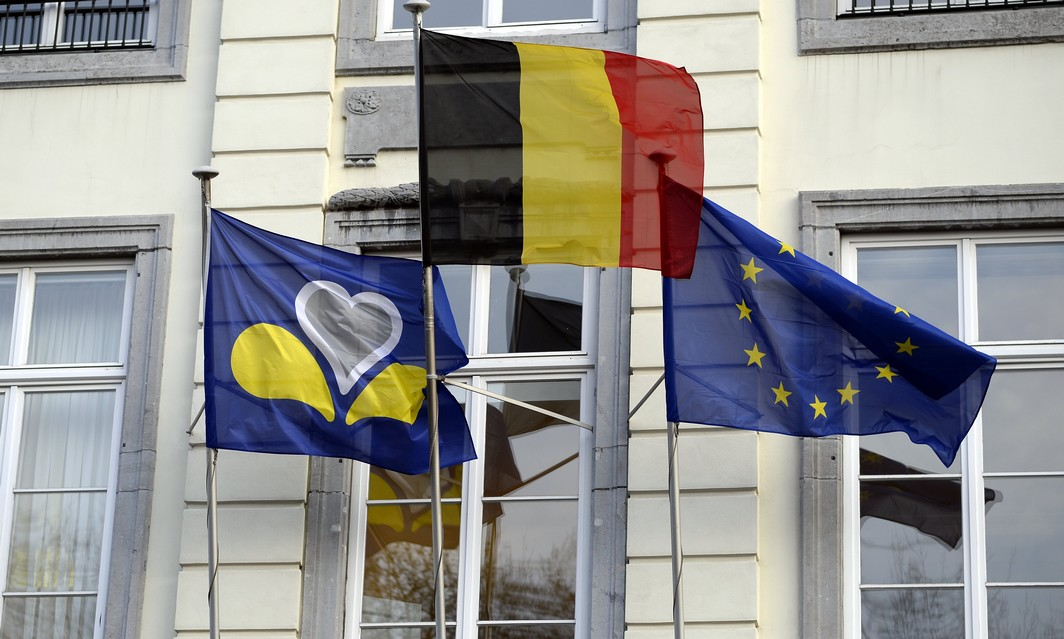 20150121 - BRUSSELS, BELGIUM: The flags of Brussels Region, Belgium and the European union pictured outside the cabinet of Brussels region Minister-President Vervoort at a meeting of Brussels Minister President with mayors of Brussels city, Schaerbeek - Schaarbeek, Molenbeek and Anderlecht to prepare a prevention plan against radicalism and for the living together, in Brussels, Wednesday 21 January 2015. BELGA PHOTO ERIC LALMAND