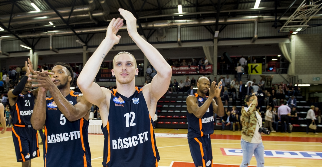 Brussels' Chris Dowe and Brussels' Augustas Peciukevicius celebrate after winning the basketball game between Limburg United and Royal Excelsior Brussels, the secondmatch (out of three) of the quarter finals of the play-offs of the EuroMillions League basket competition, on Friday 19 May 2017 in Hasselt. BELGA PHOTO JASPER JACOBS