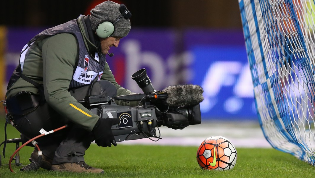 20151128 - GENK, BELGIUM: Illustration picture shows a cameraman in action during the Jupiler Pro League match between KRC Genk and KAA Gent, in Genk, Saturday 28 November 2015, on day 17 of the Belgian soccer championship. BELGA PHOTO BRUNO FAHY