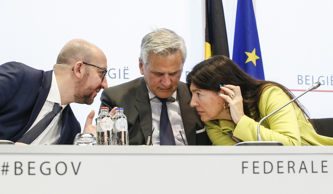 20151201 - BRUSSELS, BELGIUM: MR Belgian Prime Minister Charles Michel, CD&V Vice-Prime Minister and Minister of Employment, Economy and Consumer Affairs Kris Peeters and MR Minister of Energy, Environment and Sustainable Development Marie-Christine Marghem pictured during a press conference of the government and power companies Electrabel and Engie on the prolongation of the exploitation licenses for nuclear power plants Doel 1 and Doel 2, Tuesday 01 December 2015 in Brussels. The government and Electrabel reached an agreement to remain reactors Doel 1 and Doel 2 open until 2025. BELGA PHOTO THIERRY ROGE