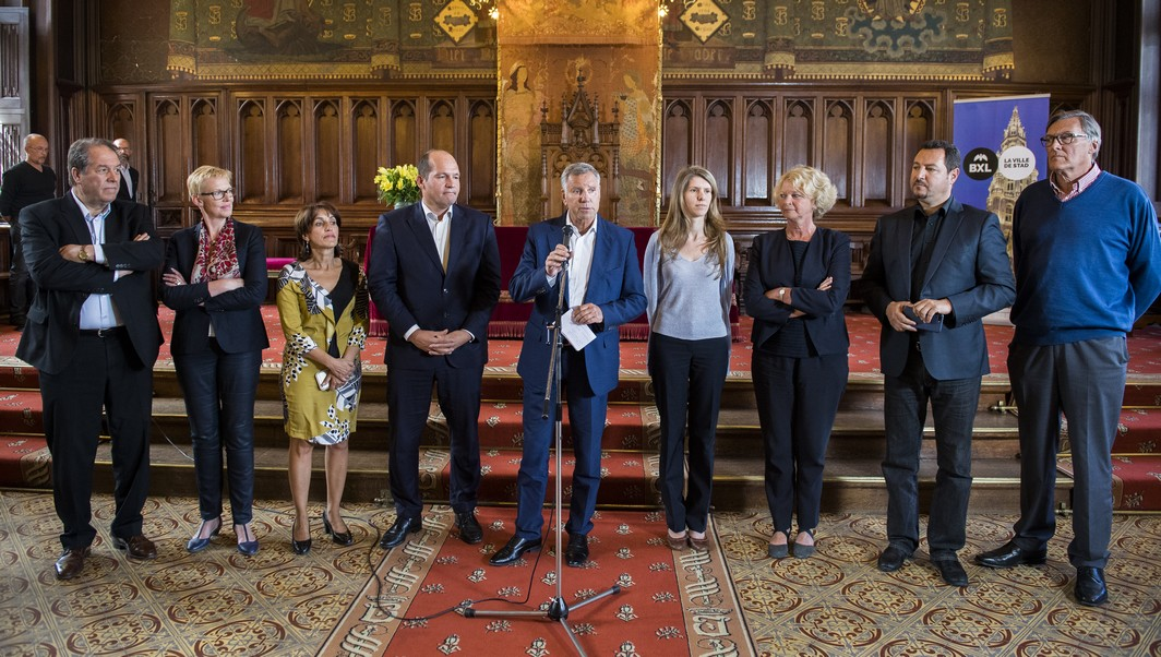 Brussels alderman Ahmed El Ktibi, Brussels alderwoman Karine Lalieux, Brussels alderwoman Faouzia Hariche, Newly Appointed Brussels Mayor Philippe Close, Brussels alderman Alain Courtois, Brussels alderwoman Els Ampe, Brussels alderwoman Marion Lemesre, PS' Mohamed Ouriaghli and MR's Jacques Oberwoits pictured during a press conference after a meeting of the Brussels' aldermen regarding the resignation of Mayor Mayeur, Friday 09 June 2017 at the Brussels city hall. Brussels Mayor Mayeur accepted general fees for attending meetings of the Samusocial, a non-profit organisation to help the homeless in the capital. Brussels alderman Close will succeed Mayeur. BELGA PHOTO LAURIE DIEFFEMBACQ