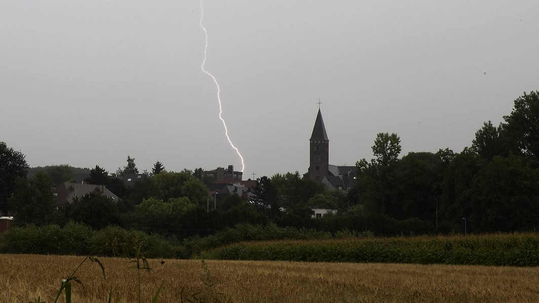 20150813 - GAVERE, BELGIUM: Illustration picture shows lightning near a church in Gavere on Thursday 13 August 2015. After a very hot day, storms were announced all over Belgium. BELGA PHOTO NICOLAS MAETERLINCK