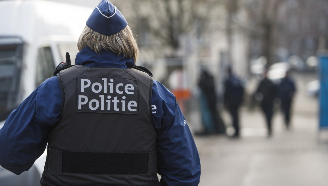 Police officer around the large security perimeter around the Rue Dries - Driesstraat in Forest - Vorst, in Brussels for the reconstruction of the shooting of last year in March 15th, where four police officers were injured and an alleged terrorist, Mohamed Belkaid, was killed, Thursday 26 January 2017. The shooting happened during a search of the apartment, part of the investigation on Paris terrorist attacks. BELGA PHOTO LAURIE DIEFFEMBACQ