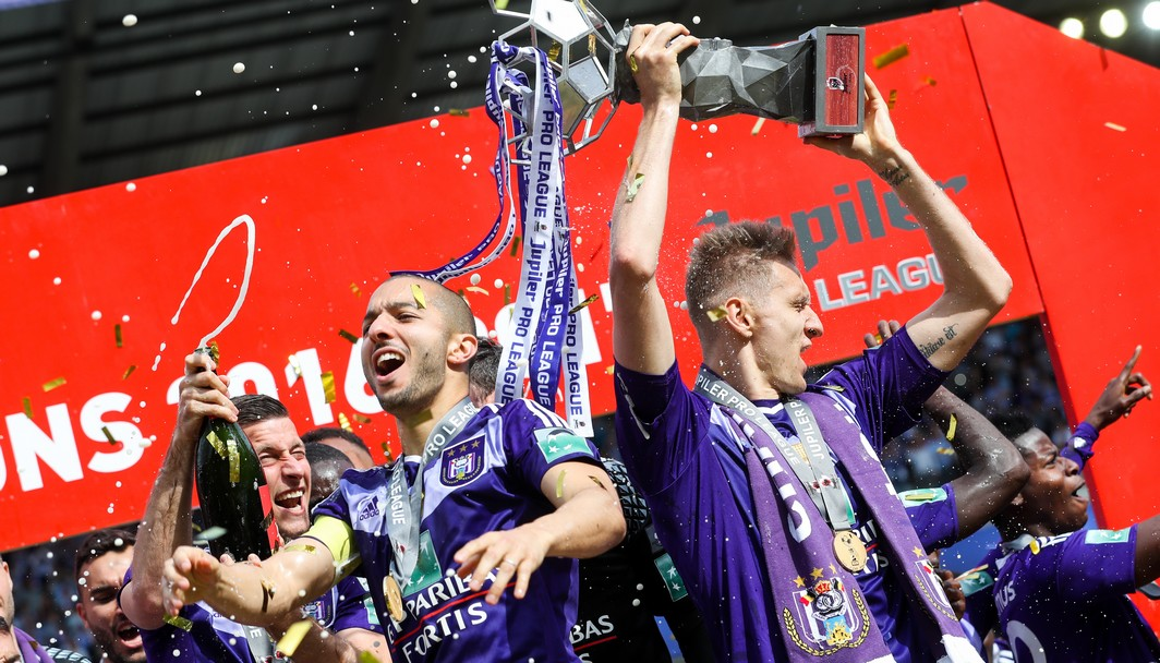 Anderlecht's Sofiane Hanni and Anderlecht's Lukasz Teodorczyk pictured during celebrations for the 34th title of Sporting Anderlecht after the Jupiler Pro League match between RSC Anderlecht and KV Oostende, in Brussels, Sunday 21 May 2017, on the last day of the Play-off 1 of the Belgian soccer championship. BELGA PHOTO VIRGINIE LEFOUR