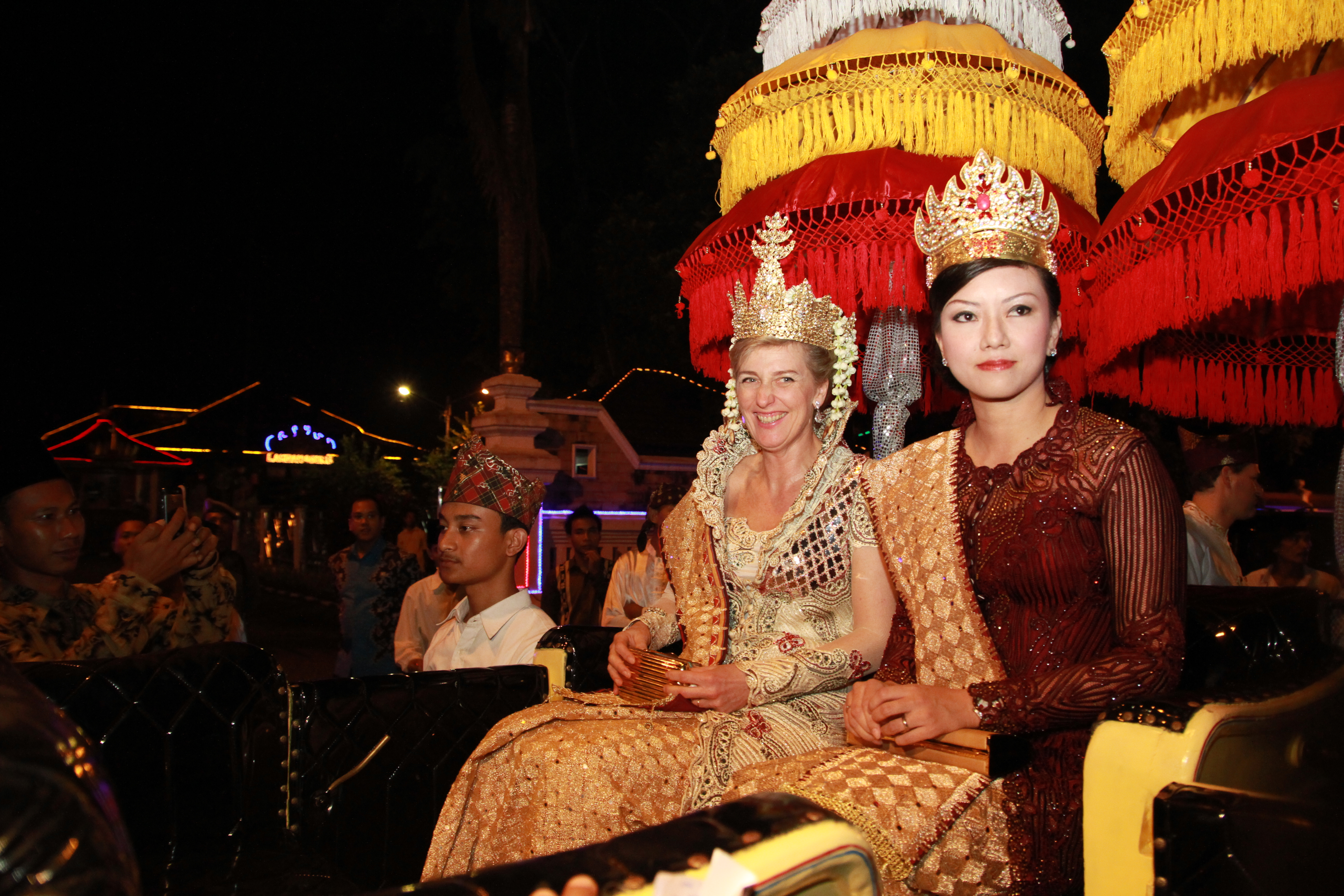 20120414 - JAKARTA, INDONESIA: This handout picture, distributed on Saturday 14 April 2012, shows Belgian Princess Astrid, Special Representative to the Roll Back Malaria Partnership, wearing a traditional dress as she sits next to Mrs Pitka Menoza, cife of the vice-governor, during a traditional ceremony to welcome Princess Astrid as a member of the community during a field visit to Bandar Lampung, with Roll Back Malaria (RBM), in Indonesia. RBM is a partnership of the World Health Organisation (WHO), UNICEF, the Global Fund and the Indonesia's Ministry of Health and aims at battling the spread of malaria. BELGA PHOTO HANDOUT ROLL BACK MALARIA