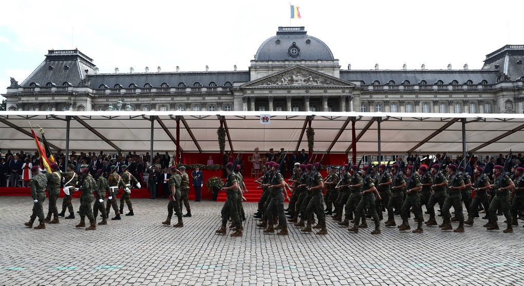 Illustration picture shows military soldiers carrying the Belgian flag during the military parade on the Belgian National Day, in Brussels, Friday 21 July 2017. BELGA PHOTO KURT DESPLENTER
