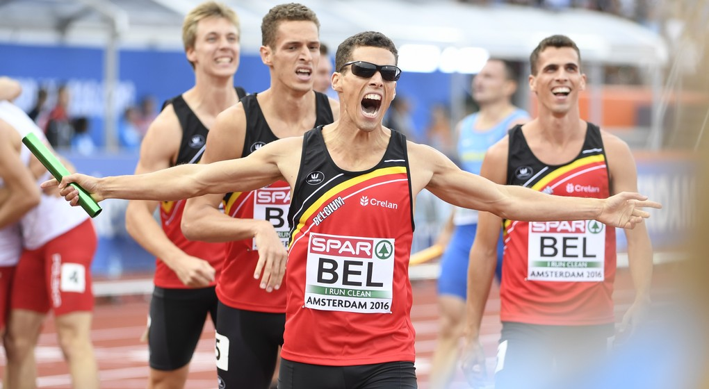 Belgian Tornadoes, Belgian Julien Watrin, Belgian Dylan Borlee, Belgian Jonathan Borlee and Belgian Kevin Borlee celebrate after winning the men's 4x400m relay at the European Athletics Championships, on Sunday 10 July 2016, at the Olympic stadium in Amsterdam, Netherlands. BELGA PHOTO JASPER JACOBS