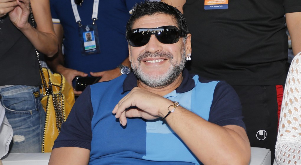 20140208 - DUBAI, UNITED ARAB EMIRATES: Former soccer player Diego Maradona pictured during the final stage of the Dubai Tour 2014 cycling race, 124 km from Dubai to Burj-Khalifa, in Dubai, United Arab Emirates, Saturday 08 February 2014. The Dubai Tour 2014 is taking place from 5 to 8 February.  BELGA PHOTO YUZURU SUNADA