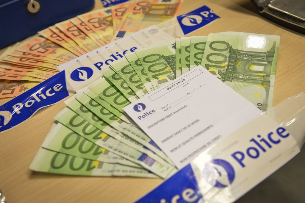 20150220 - TOURNAI, BELGIUM: Illustration picture shows confiscated cash money at a press conference after police confiscated drugs during an investigation, Friday 20 February 2015 in Tournai. BELGA PHOTO DAVID STOCKMAN