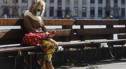 Confinement - Femme seule Grand Place de Bruxelles - Belga Thierry Roge