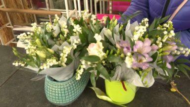 Distribution de muguet : les commerçants solidaires avec une fleuriste à l'aube du 1er mai